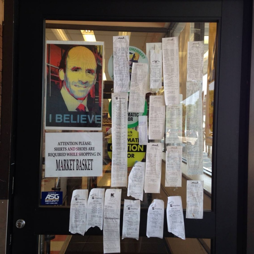 Customers grocery slips from other stores on Market Basket's door
