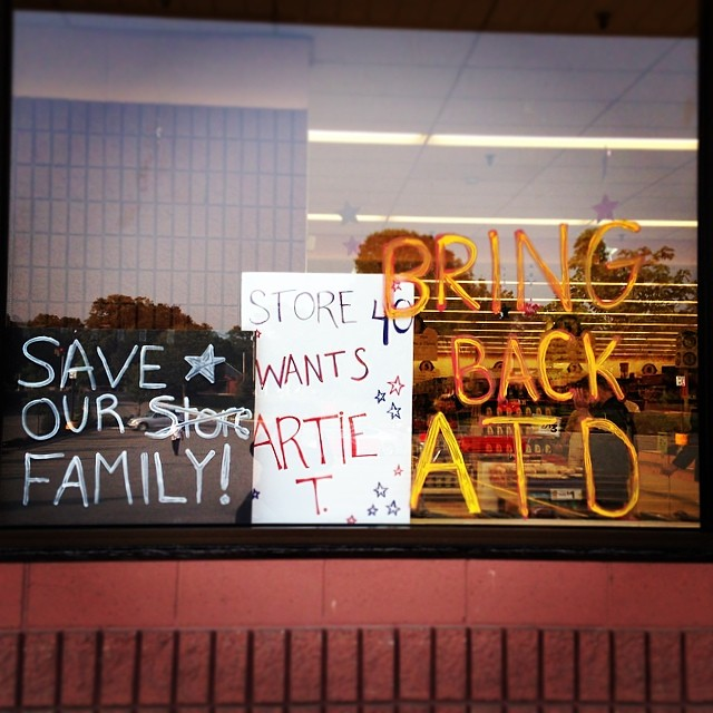 Signs on Newburyport's Market Basket's front window