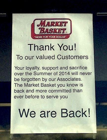 Market Basket sign inside window