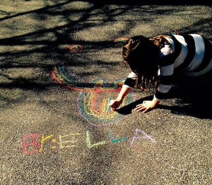Ella, working hard making the neighborhood beautiful with street art