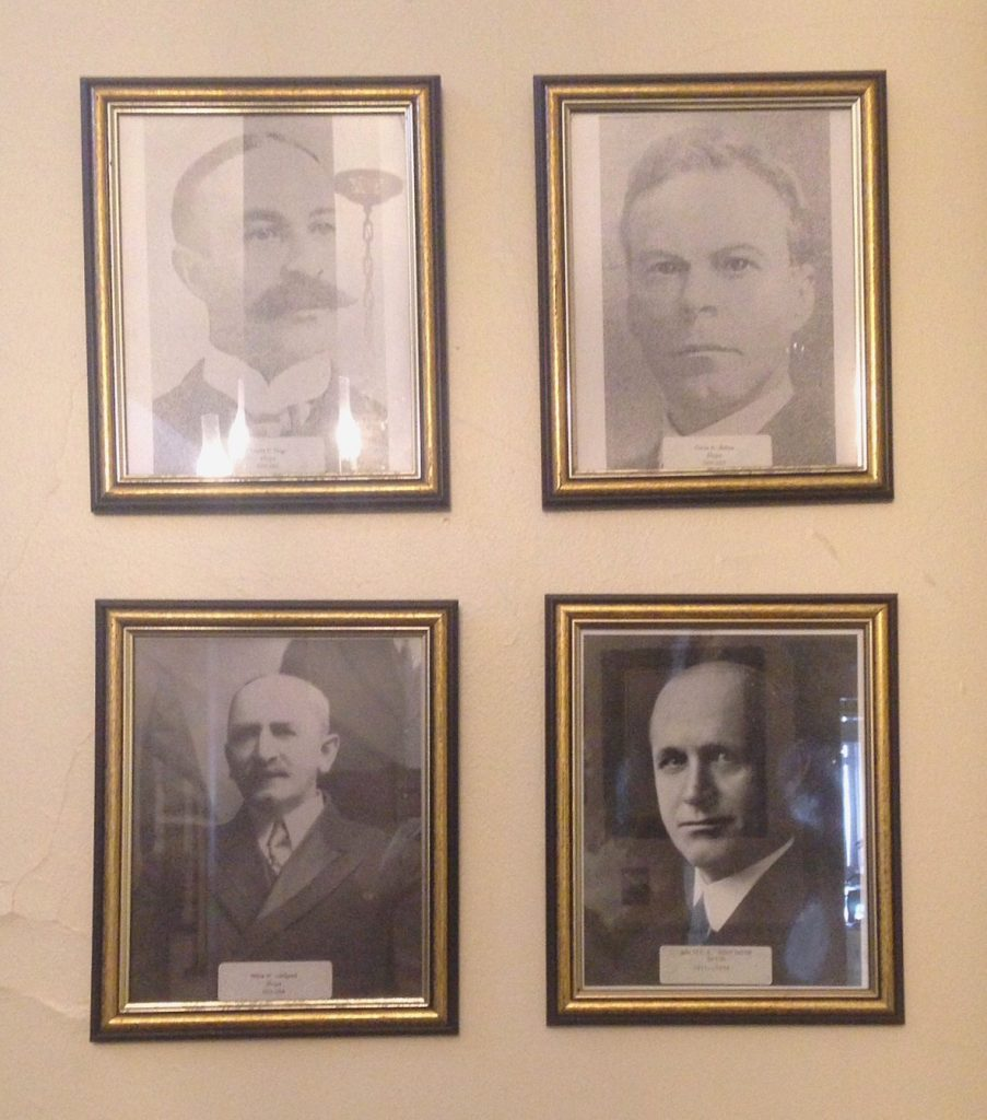 Portraits of four mayors of Newburyport, Walter B. Hopkinson is the portrait on the lower right hand side.