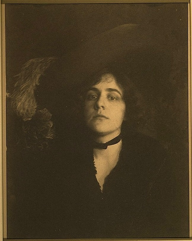 """The Gainsborough hat"" Photograph showing a woman (Ethel Reed), head-and-shoulders portrait, facing front, wearing a plumed hat, by F. Holland Day, 1895, courtesy of the Library of Congress Prints and Photographs Division Washington, D.C"